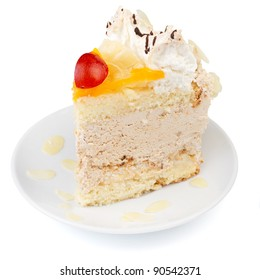 Close-up of a creamy cake with fruits and almonds