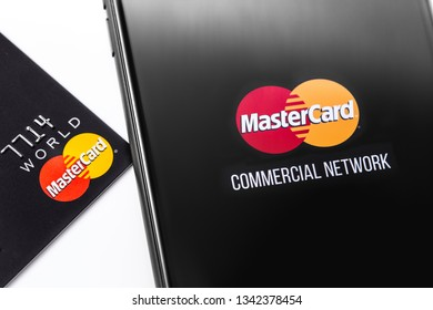 closeup credit card and smartphone with MasterCard logo on the screen. Mastercard one of the two biggest credit card companies in the world. Moscow, Russia - March 12, 2019