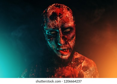 Close-up of a creepy scary zombie. Halloween. Horror film.