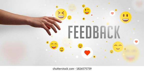 Close-Up of cropped hand pointing at FEEDBACK inscription, social media concept