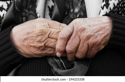 Closeup cropped image. Aging process hands of very old senior, elderly woman with wrinkled skin. Longevity.