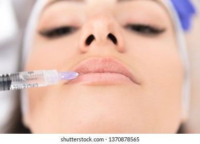 Closeup cropped image of female patient having mesotherapy of her lips, Aesthetic corrective treatments concept