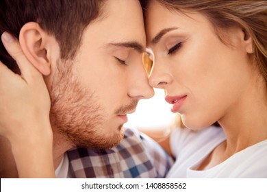 Close-up cropped portrait of his he her she nice-looking gorgeous attractive charming bearded guy caressing lady ideal match honey moon in light white style interior hotel house indoors