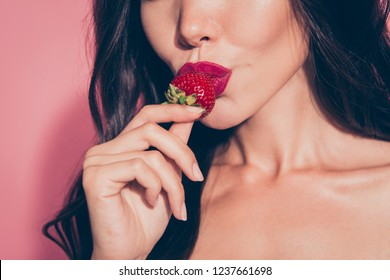 Close-up cropped portrait of nice lovely sweet girlish glamorous attractive adorable wavy-haired lady eating biting licking tasting enjoying dessert red lips isolated over pink pastel background