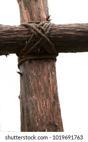 Closeup Cross Against the Gray Sky
