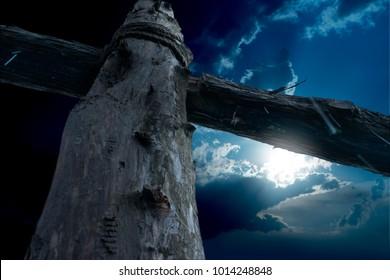 Closeup Cross of Jesus at Night in the Rain