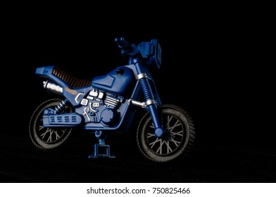 Close-up of cross motorbike motorcycle toy Object on a black Background