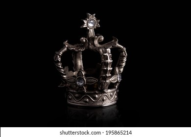 a closeup of a crown with black background