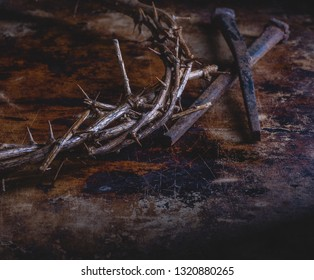 Closeup of crown of thorns and nails on an abstract background