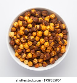 Close-Up of Crunchy Roasted Chana Masala in white Ceramic bowl, made with Bengal Grams or Chickpeas. Indian spicy snacks (Namkeen), Top View