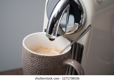 closeup of cup of coffee expresso on cofffee machine