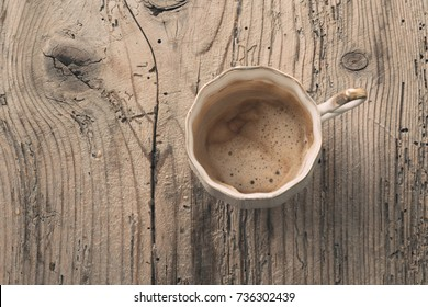 Closeup of cup of coffee over wooden background