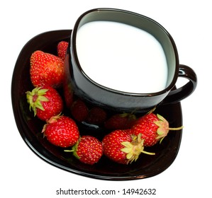 close-up cup of milk and strawberries