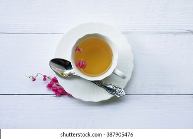Closeup of cup of tea on wooden table with blur background.Flat lay.still life with tea cup.