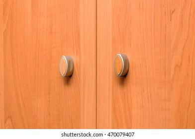 Close-up cupboard wood door, cabinet in kitchen.