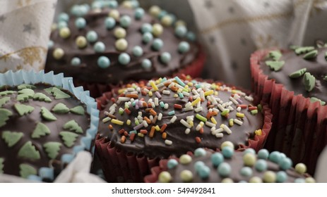 Close-up of cupcakes with chocolate icing and sugar decorations
