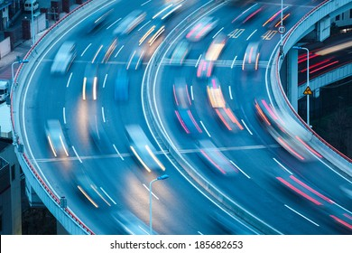 closeup of the curve lanes with car motion blur