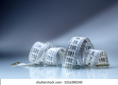 Close-up curved measuring tape.