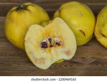 Closeup of cut apple quince. juicy ripe fragrant yellow quince on a wooden table