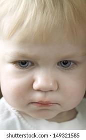 Closeup of cute baby girl looking away