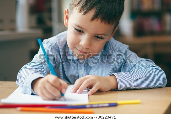 Closeup Cute Boy Doing Homework Coloring Stock Photo Edit Now 700223491