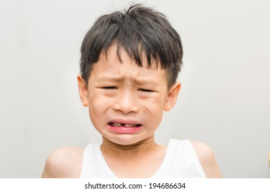 Closeup of cute little  Asian boy  crying