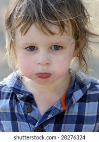 A close-up of a cute sad baby boy