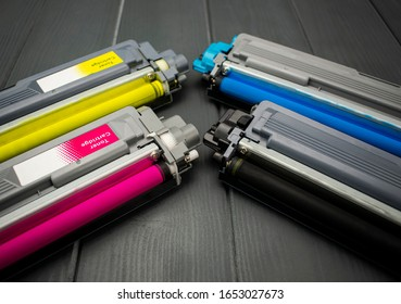 Close-up of cyan and yellow replacement cartridges for the toner of a color laser printer