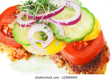 closeup of a danish open faced sandwich or smoerbroed with carrot patties, otherwise known as vegetarian frikadelles.