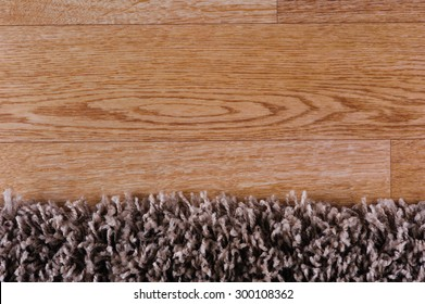 closeup of dark brown carpet on a wood surface