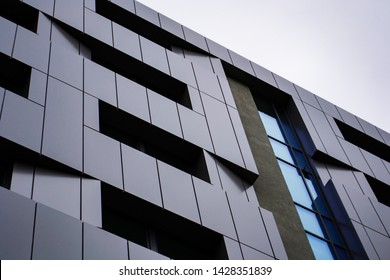 Close-up of Dark grey metallic panel facad. Modern architectural details.