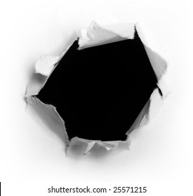 Closeup of a dark hole on white paper