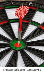 Closeup of dart board with dart.