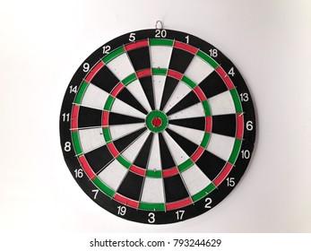 Closeup dartboard target on white background. Selective focus.