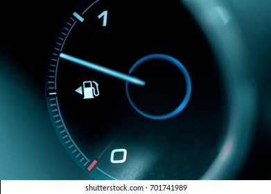 Close-up of the dashboard and fuel gauge in the car