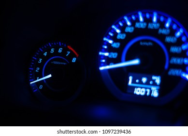 Closeup dashboard of mileage car with light blue