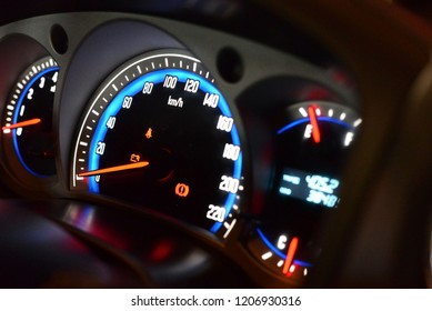 Closeup dashboard of mileage car in night time.