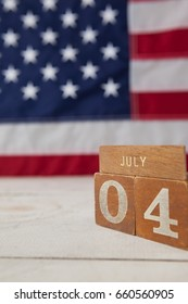 Close-up of date blocks arranged against American flag background