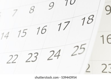 Closeup of dates 17 on calendar page