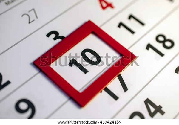 Closeup of dates on calendar page - 10