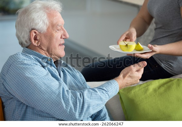 Close-up of daughter caring about senior father
