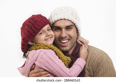 Close-up of daughter and father embracing