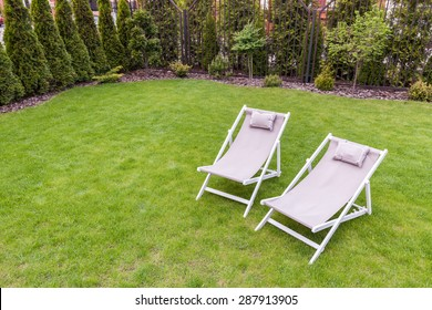 Close-up of deck chairs in the garden