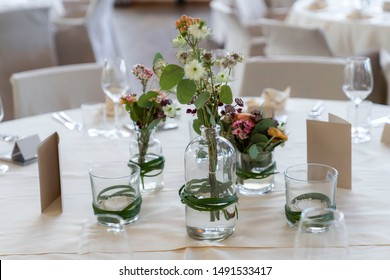 Closeup of decorated wedding tables, with flowers serviette and cutlery