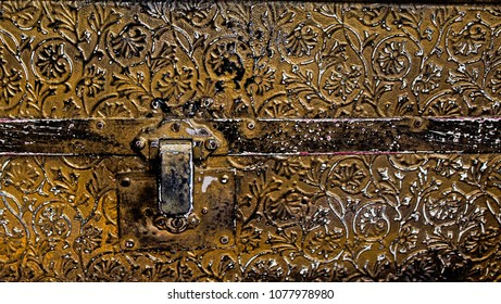Closeup of the Decorative Details and Latch on a Vintage Trunk