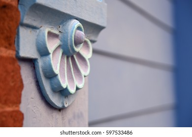 Closeup of a decorative pale blue wooden rosette on a house exterior in Silver City, New Mexico, USA