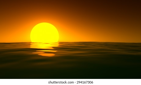 A closeup of the deep orange sun setting over the gently lapping waves of the sea