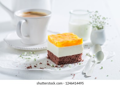 Closeup of delicious cake with jelly and served with coffee