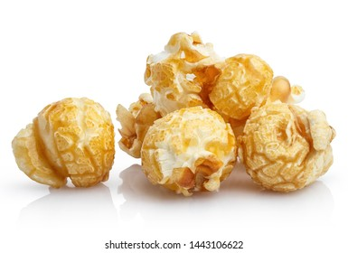 Close-up of delicious caramel popcorn, isolated on white background