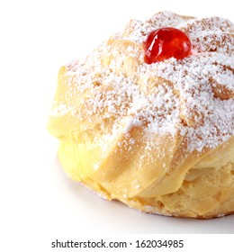 Closeup of delicious Cherry puff pastry with powdered sugar on white background